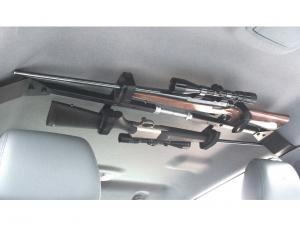 vendor.2013.great-day.cl1500-gun-rack.mounted-wth-gun.in-truck-cabin.jpg