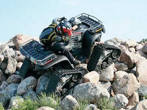 vendor.2013.mattracks.litefoot.on-atv.over-rocks.jpg