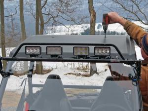 vendor.2014.extreme-metal-products.installing-roof.on-polaris-rzr.JPG