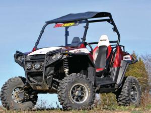 vendor.2014.superatv.polaris-rzr.lift-kit.white-and-red.custom-rzr.parked.on-dirt.jpg