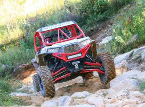 vendor.2016.houser-racing.custom-polaris-rzr1000.red_.front_.riding.over-rocks.jpg