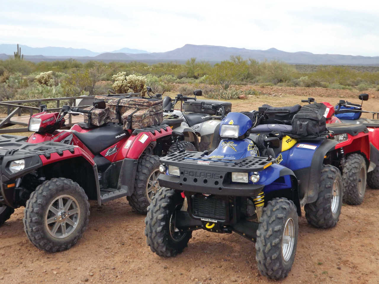 vendor.2014.rm-stator.polaris-sportsman.parked.on-trail.jpg