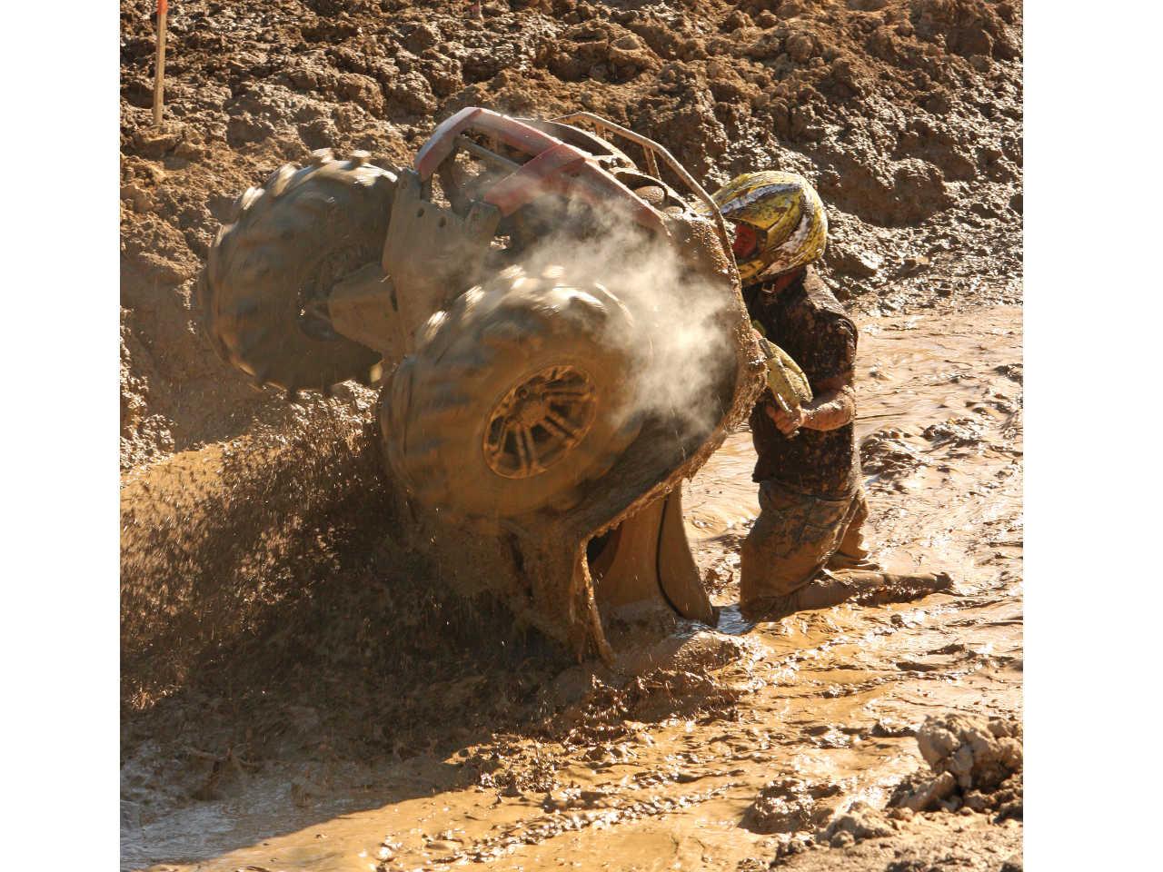 vendor.2015.design-engineering-inc.radiator-relief.atv-riding-through-mud.jpg