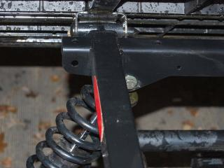 For working with heavy loads on a regular basis, riders can bolt the upper shock mount into a second location which stiffens the suspension for the added weight. It's a great feature.